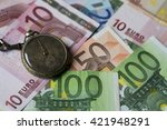 old watch with euro banknotes | Shutterstock . vector #421948291