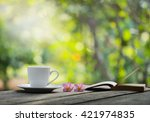 white coffee cup with book and  ... | Shutterstock . vector #421974835