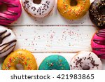 Donuts On A Wooden Background...