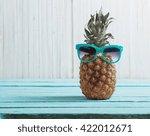 ripe pineapple on a wooden... | Shutterstock . vector #422012671