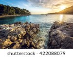 Sunset At Rocky Stone Beach At...