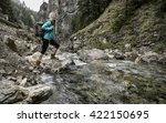 Woman Hiking Around Mountains...