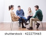 young people sitting in circle... | Shutterstock . vector #422275465