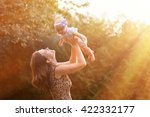 Young Mother Holding Daughter...