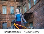 young stylish woman and bike in ... | Shutterstock . vector #422348299