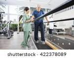 physiotherapist standing by... | Shutterstock . vector #422378089