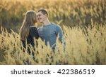 couple on meadow | Shutterstock . vector #422386519
