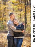 couple in the autumn forest | Shutterstock . vector #422386789
