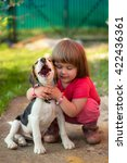 cute little girl with a beagle... | Shutterstock . vector #422436361