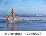 Happy Barefoot Family Having...