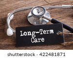 stethoscope on wood with... | Shutterstock . vector #422481871