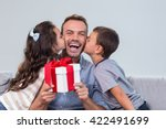 father holding a gift and... | Shutterstock . vector #422491699