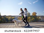 Stock photo fitness sport people and jogging concept happy couple with dog running outdoors 422497957