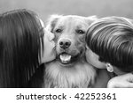 teenagers kissing dog | Shutterstock . vector #42252361