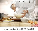 making cake in kitchen  | Shutterstock . vector #422526901