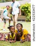 happy family doing bubbles   Shutterstock . vector #422533477
