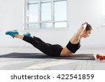 beautiful slim brunette  doing... | Shutterstock . vector #422541859