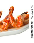 Closeup of BBQ shrimp skewers with sweet garlic chili sauce isolated on white background - stock photo