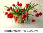 Still Life With Red Tulips .