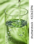 glass and pouring water on green | Shutterstock . vector #42262396