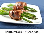 teriyaki marinated beef rolled around asparagus, popular Japanese appetizer - stock photo