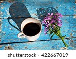 coffee mug with pink flowers on ... | Shutterstock . vector #422667019