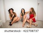 three beautiful girls getting... | Shutterstock . vector #422708737