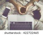 relaxing behind a laptop... | Shutterstock . vector #422722465