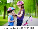 adorable girl helping her... | Shutterstock . vector #422741701
