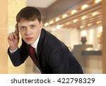 Small photo of Cuckold concept. Businessman spying by listening through wall with glass