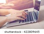woman hands using laptop on... | Shutterstock . vector #422809645