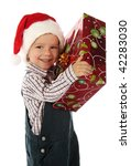 Smiling little boy with Christmas gift box - stock photo