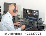 a video editor in his studio | Shutterstock . vector #422837725
