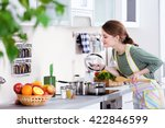 Young Woman Cooking In The...