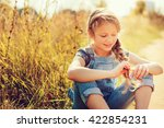 cheerful child girl in jeans... | Shutterstock . vector #422854231