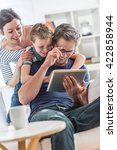 at home  dad  mom and their...   Shutterstock . vector #422858944
