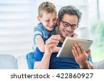 at home  a father and his young ... | Shutterstock . vector #422860927