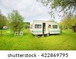 caravan trailer camping on a... | Shutterstock . vector #422869795
