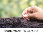 farmer's hand planting a seed... | Shutterstock . vector #422876611