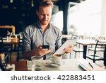 busy blogger multitasking in... | Shutterstock . vector #422883451
