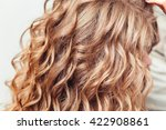 close up of curly blond hair in ... | Shutterstock . vector #422908861