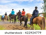 Group Of Horseback Riders In...