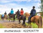 Group Of Horseback Riders In...