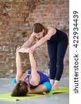 instructor helps to do yoga... | Shutterstock . vector #422934439
