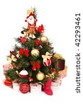 Christmas tree with baubles, balls and bows ornaments and gifts. A lovely traditional Christmas tree decorated in red and gold color. - stock photo