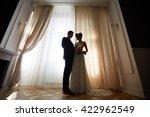 happy bride and groom standing... | Shutterstock . vector #422962549