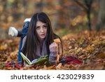 girl reading a book | Shutterstock . vector #423029839