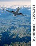 Small photo of passenger airplane in the clouds. travel by air transport