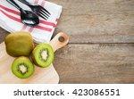 kiwi on wooden background. | Shutterstock . vector #423086551