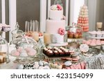 pink assortie of the cakes and... | Shutterstock . vector #423154099